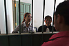 IBJ Lawyer Hok Mengeam and Dalis Sim, also from IBJ meet with a defendant before his trial.