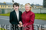Darragh Hanrahan and Mary Moore O'Regan  holding  their Great-Grand uncle's medals , at the Scoil Íosagain, Ballybunnion  1916 rising commemoration on Friday