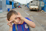 A boy makes a face in a camp for internally displaced families in Ankawa, near Erbil, Iraq. Residents of the camp, mostly Christians, were displaced from Mosul, Qaraqosh and other communities in Iraq when ISIS swept through the area in 2014.