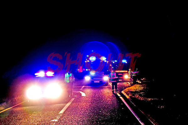Fire engine and police car on emergency call. This image may only be used to portray the subject in a positive manner..©shoutpictures.com..john@shoutpictures.com