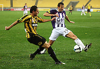 Perth's Naum Sekulovski blocks Leo Bertos' cross during the A-League football match between Wellington Phoenix and Perth Glory at Westpac Stadium, Wellington, New Zealand on Sunday, 16 August 2009. Photo: Dave Lintott / lintottphoto.co.nz