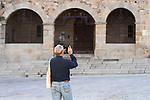 A man takes a photo of Plaza Mayor during the first day of liftning of the confinement restrictions in Caceres, Extremadura. 02 May 2020(Alterphotos/Francis Gonzalez)