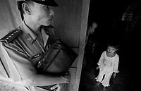 Dong Son / Valle di A-Luoi / confine Laos - Vietnam.<br /> Conseguenze guerra Vietnam 40 anni dopo.La catastrofe ambientale e sociale è ancora evidente in alcune aree rurali altamente inquinate dalla diossina come la Valle di A-Luoi, ad ovest di Huè, nei pressi della frontiera col Laos.Qui la vita degli abitanti - gruppi minoritari di etnia Pa Co - è molto difficile.Un grande cartello all'entrata del villaggio di Dong Son ricorda il pericolo di contaminazione: vietato coltivare e bere l'acqua dei pozzi.<br /> Nella foto la piccola Ho Thi Nga, di 7 anni, non parla, non sente, soffre di epilessia.<br /> Foto Livio Senigalliesi.<br /> Dong Son/A-Luoi Valley/Laos - Vietnam border.<br /> Consequenses of the war in Vietnam 40 years later.The environmental and social disaster is still evident in some rural areas highly polluted by dioxine, like the Valley of A-Luoi, west of Huè, close to the border with Laos. Here the life of the inhabitants, of the ethnic minority Pa Co, is very hard. In the picture Ho Thi Nga (7) affected by dioxine syndrome, she is deaf-dumb and suffer for epilepsy.<br /> Photo Livio Senigalliesi