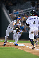 Casey Gillaspie (16) of the Durham Bulls waits for a throw as Everth Cabrera (4) hustles down the first base line at BB&T BallPark on May 15, 2017 in Charlotte, North Carolina. The Knights defeated the Bulls 6-4.  (Brian Westerholt/Four Seam Images)