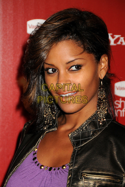 CLAUDIA JORDAN.US Weekly's Hot Hollywood Party 2009 held at Voyeur, West Hollywood, California, USA..November 18th, 2009.headshot portrait dangling gold earrings black leather purple .CAP/ADM/BP.©Byron Purvis/AdMedia/Capital Pictures.
