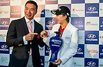 Tenniel Chu Vice Chairman of Mission Hills Group (L) poses with Hyo Joo Kim of Korea during the Hyundai China Ladies Open 2014 at World Cup Course in Mission Hills Shenzhen on December 14<br />