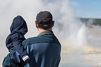 Father and son take in the sights in Yellowstone.
