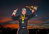 Oct 28, 2018; Las Vegas, NV, USA; NHRA top fuel driver Steve Torrence poses for a portrait in front of the sunset as he celebrates after winning the Toyota Nationals at The Strip at Las Vegas Motor Speedway. Mandatory Credit: Mark J. Rebilas-USA TODAY Sports