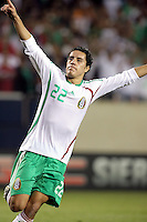 Mexico's Efrain Juarez (22) celebrates after converting his penalty kick.  Mexico defeated Costa Rica 2-1 on penalty kicks in the semifinals of the Gold Cup at Soldier Field in Chicago, IL on July 23, 2009.