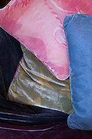 Detail of silk velvet cushions by Caroline Ede on her sofa