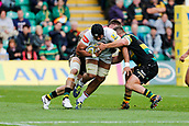 9th September 2017, Franklins Gardens, Northampton, England; Aviva Premiership Rugby, Northampton Saints versus Leicester Tigers; Sione Kalamafoni of Leicester Tigers is tackled by Alex Waller and Teimana Harrison of Northampton Saints