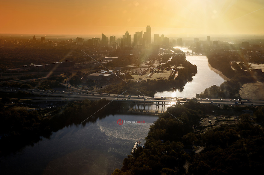 Aerial view from a helicopter of the downtown Austin skyline, Mopac Expressway Bridge over Lady Bird Lake during early morning sunrise in downtown Austin, Texas.