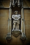 Statue of King Henry IIX on Cambridge University college wall, England