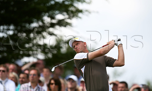23.06.2012. Pulheim, Cologne, Germany. German golfer Marcel Siem watches his shot during the BMW International Open golf tournament in Pulheim near Cologne, Germany, 23 June 2012.