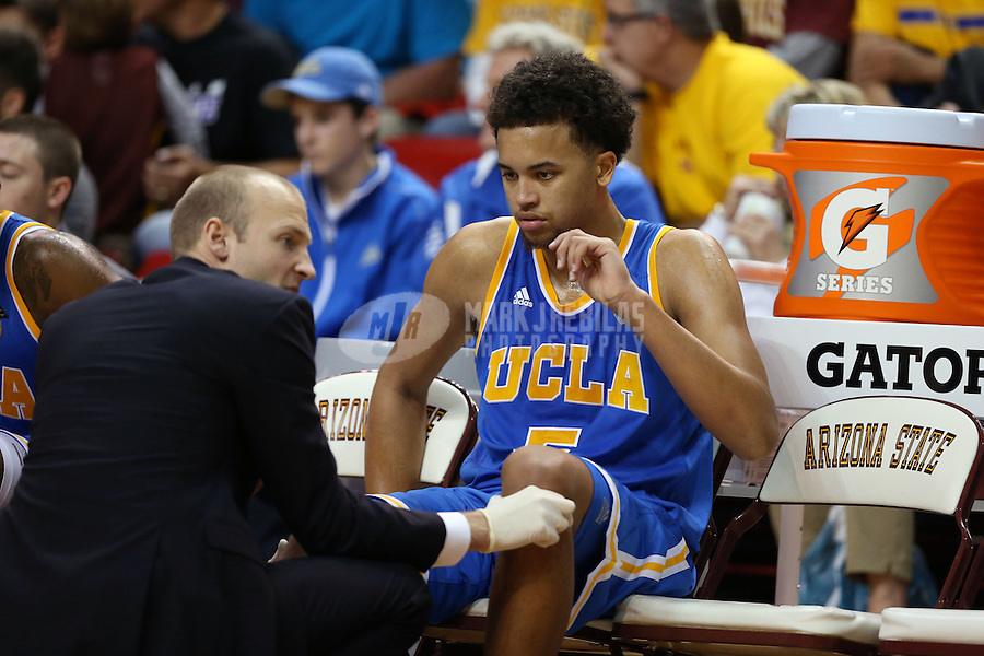 Jan. 26, 2013; Tempe, AZ, USA: UCLA Bruins guard Kyle Anderson (5) is tended to by a trainer on the bench against the Arizona State Sun Devils at the Wells Fargo Arena. Arizona State defeated UCLA 78-60. Mandatory Credit: Mark J. Rebilas-USA TODAY Sports