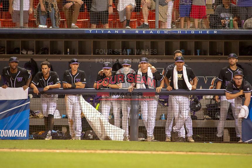 University of Washington Huskies watch intently from the dugout during the game against the Cal State Fullerton Titans at Goodwin Field on June 10, 2018 in Fullerton, California. The Huskies defeated the Titans 6-5. (Donn Parris/Four Seam Images)