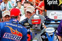 19 June, 2011: Kyle Busch congratulates race-winner Denny Hamlin after the 43rd Annual Heluva Good! Sour Cream Dips 400 at Michigan International Speedway in Brooklyn, Michigan. (Photo by Jeff Speer :: SpeerPhoto.com)