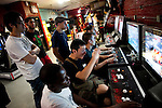 NEW YORK  --  JULY 17, 2010:  Chris Hu (C), 26, of Manhattan; plays Rhys London (2L), 21, of Brooklyn;  on the Street Fighter IV video game at the Chinatown Fair Video Arcade on Mott Street in Chinatown on July 17, 2010 in New York City.  Hu just returned from a video game tournament in Las Vegas.  (PHOTOGRAPH BY MICHAEL NAGLE)