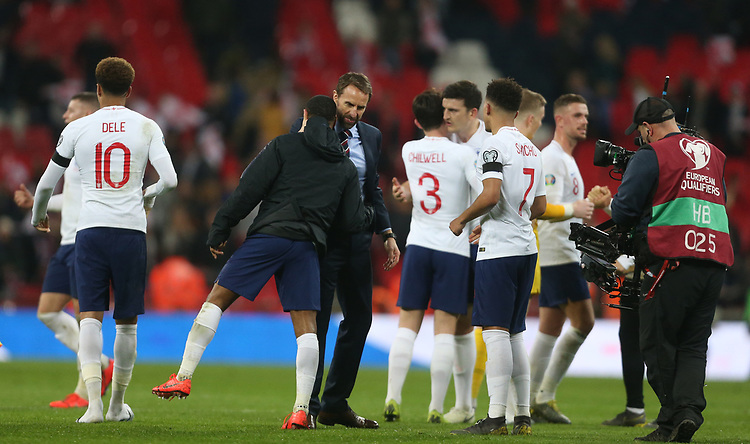 England's Coach Gareth Southgate with Raheem Sterling at the end of the game<br /> <br /> Photographer Rob Newell/CameraSport<br /> <br /> UEFA Euro 2020 Qualifying round - Group A - England v Czech Republic - Friday 22nd March 2019 - Wembley Stadium - London<br /> <br /> World Copyright © 2019 CameraSport. All rights reserved. 43 Linden Ave. Countesthorpe. Leicester. England. LE8 5PG - Tel: +44 (0) 116 277 4147 - admin@camerasport.com - www.camerasport.com