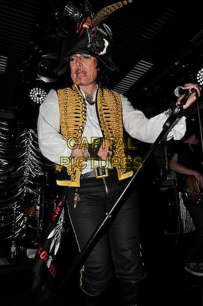 Adam Ant.performing live in concert during his new tour, Under the Bridge, Chelsea Football Club, London, England, UK, .August 5th 2011..half  length music gig live on stage side feathers waistcoat  glasses pirate hat make-up costume white shirt microphone .CAP/IA.©Ian Allis/Capital Pictures.