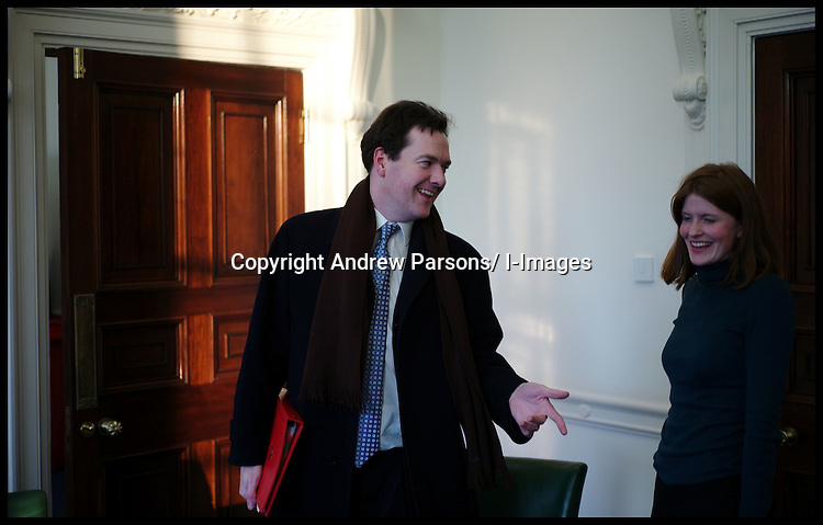 Chancellor of the Exchequer George Osborne with an aide in his office before going to a meeting at No10, Tuesday February 7, 2012. Photo By Andrew Parsons/i-images.... , Monday February 6, 2012. Photo By i-Images