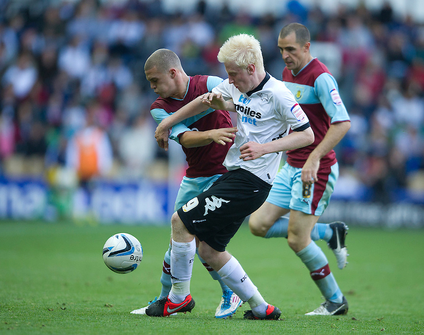 Burnley's Kieran Trippier shields the ball from Derby County's Will Hughes ..Football - npower Football League Championship - Derby County v Burnley - Saturday 22nd September 2012 - Pride Park - Derby..