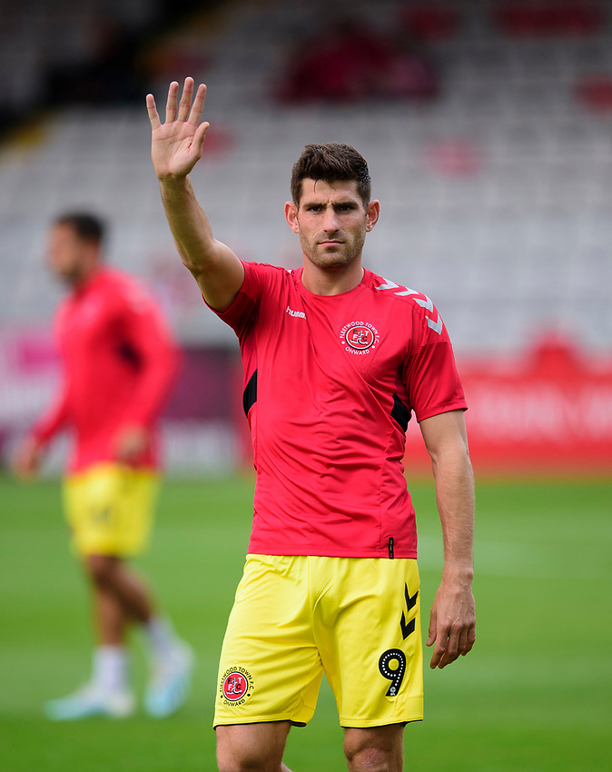 Fleetwood Town's Ched Evans during the pre-match warm-up<br /> <br /> Photographer Andrew Vaughan/CameraSport<br /> <br /> The EFL Sky Bet League One - Lincoln City v Fleetwood Town - Saturday 31st August 2019 - Sincil Bank - Lincoln<br /> <br /> World Copyright © 2019 CameraSport. All rights reserved. 43 Linden Ave. Countesthorpe. Leicester. England. LE8 5PG - Tel: +44 (0) 116 277 4147 - admin@camerasport.com - www.camerasport.com