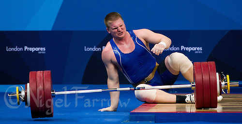 11 DEC 2011 - LONDON, GBR - Dmitriy Kaplan (KAZ) fails a lift during the men's +105kg category Clean and Jerk at the London International Weightlifting Invitational and 2012 Olympic Games test event held at the ExCel Exhibition Centre in London, Great Britain .(PHOTO (C) NIGEL FARROW)