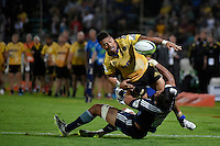Ardie Savea ( Hurricanes ) and Steven Luatua ( Blues ) in action during the Super Rugby - Hurricanes v Blues at FMG Stadium, Palmerston North, New Zealand on Friday 13 March 2015. <br /> Photo by Masanori Udagawa. <br /> www.photowellington.photoshelter.com.