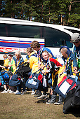 Swedish scouts are about to unload a bus at the bus stop.