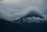 Clouds mover over a peak in the Chugach Mountains, Alaska.