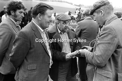 Appleby Gypsy Fair 1981. Gypsy horse dealer and horse dealer. Money changing hands.