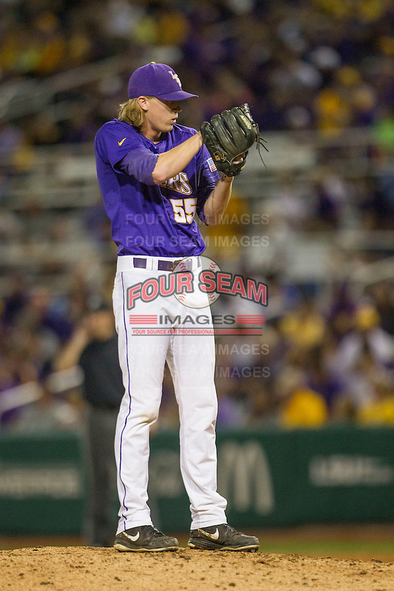 LSU Tigers pitcher Hunter Newman (55) looks to his catcher for the sign during a Southeastern Conference baseball game against the Texas A&M Aggies on April 24, 2015 at Alex Box Stadium in Baton Rouge, Louisiana. LSU defeated Texas A&M 9-6. (Andrew Woolley/Four Seam Images)