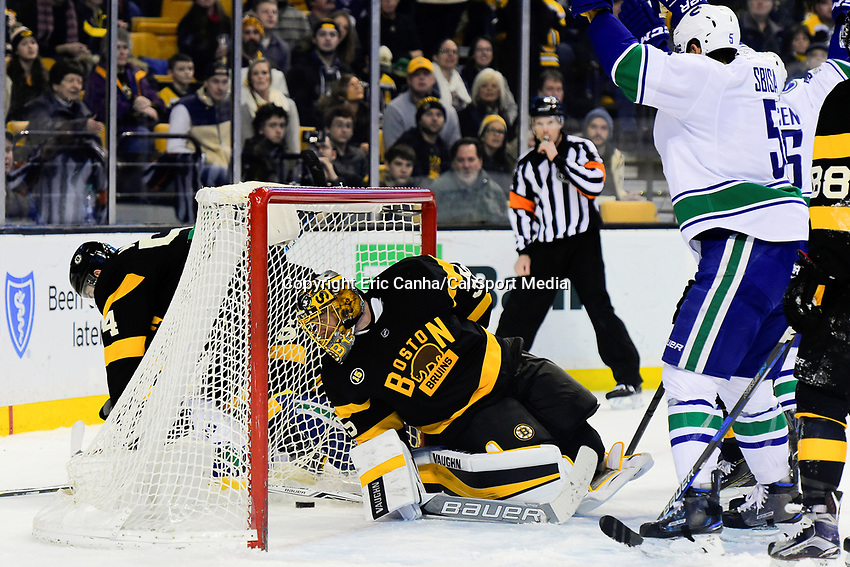 February 11, 2017: Boston Bruins goalie Anton Khudobin (35) looks back at the puck that got by during the National Hockey League game between the Vancouver Canucks and the Boston Bruins held at TD Garden, in Boston, Mass. Boston defeats Vancouver 4-3 in regulation time. Eric Canha/CSM