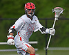 Sean Lulley #33 of Hills East circles behind the net during the third quarter of the Suffolk County varsity boys lacrosse Division I (Class A) quarterfinals against Commack at Half Hollow Hills High School East on Friday, May 19, 2017. He scored three goals in Hills East's 11-9 win.