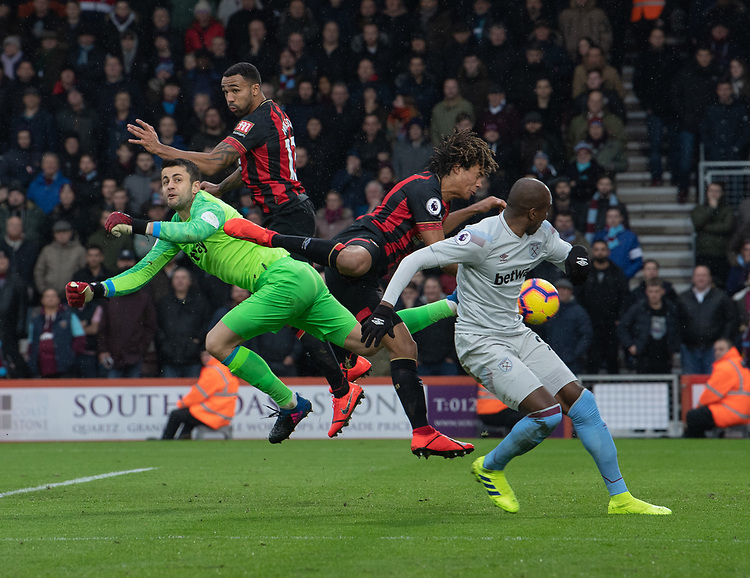 West Ham United's Lukasz Fabianski (left) goal keeper battles with Bournemouth's Callum Wilson and Nathan Ake<br /> <br /> Photographer David Horton/CameraSport<br /> <br /> The Premier League - Bournemouth v West Ham United - Saturday 19 January 2019 - Vitality Stadium - Bournemouth<br /> <br /> World Copyright &copy; 2019 CameraSport. All rights reserved. 43 Linden Ave. Countesthorpe. Leicester. England. LE8 5PG - Tel: +44 (0) 116 277 4147 - admin@camerasport.com - www.camerasport.com
