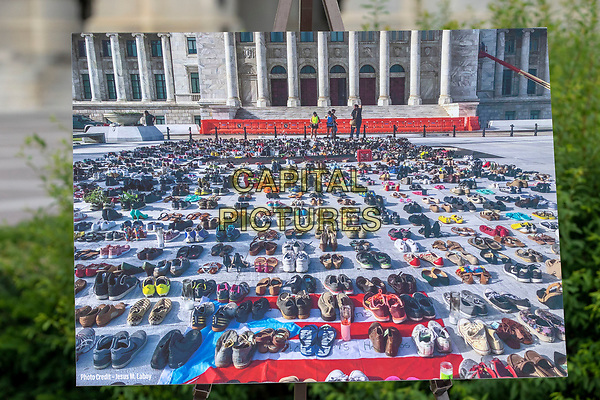 A photo of pairs of shoes representing people killed during Hurricane Maria is seen during a press conference held by the United States House of Representatives Hispanic Caucus on Capitol Hill in Washington, DC on June 6, 2018.<br /> <br /> CAP/MPI/RS<br /> &copy;RS/MPI/Capital Pictures