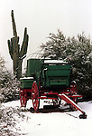 Chuck wagon and saguaro cacti in snow Wickenburg Arizona, chuck wagon, Saguaros, carnegiea gigantea, cacti of Southwest, Sonoran Desert, Southwest, Arizona, State of Arizona, Southwest, desert, 48th State, Last of contiguous states,Grand Canyon, Indian reservations, four corners, desert landscape, exrophyte, western United States, Southwest, Mountains, plateaus, ponderosa pines, Colorado River,  Mountain lion, Navajo Nation,  Arizona Territory, Fine Art Photography by Ron Bennett, Fine Art, Fine Art photography, Art Photography, Copyright, RonBennettPhotography.com,Stock and Fine Art Photography by Ron Bennett, Fine Art, Fine Art photography, Bennett, Art Photography, Copyright RonBennettPhotography.com,