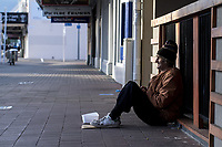 Petone resident Ricky Hurren begs on Jackson Street at 7.45am during the national lockdown for COVID-19 pandemic in Petone, New Zealand on Monday, 6 April 2020. Photo: Dave Lintott / lintottphoto.co.nz