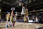 Doral Moore (4) of the Wake Forest Demon Deacons flies to the basket past Josh Okogie (5) of the Georgia Tech Yellow Jackets during second half action at the LJVM Coliseum on February 14, 2018 in Winston-Salem, North Carolina.  The Demon Deacons defeated the Yellow Jackets 79-62.  (Brian Westerholt/Sports On Film)