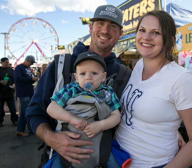 Matt, Lindsayand one-year-old Tony during the Reno Rodeo Nevada Blue Night on Wednesday, June 26, 2019.