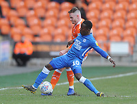 Blackpool's Oliver Turton under pressure from Peterborough United's Siriki Dembele<br /> <br /> Photographer Kevin Barnes/CameraSport<br /> <br /> The EFL Sky Bet League One - Blackpool v Peterborough United - Saturday 13th April 2019 - Bloomfield Road - Blackpool<br /> <br /> World Copyright &copy; 2019 CameraSport. All rights reserved. 43 Linden Ave. Countesthorpe. Leicester. England. LE8 5PG - Tel: +44 (0) 116 277 4147 - admin@camerasport.com - www.camerasport.com