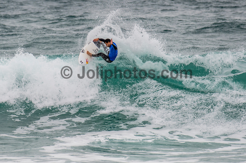 BELLS BEACH, Victoria/AUS (Monday, March 28, 2016) Michel Bourez (PYF) - Action at the Rip Curl Pro Bells Beach, the second stop on the World Surf League (WSL) Championship Tour (CT), continued today with the remaining six heats of Round Three before the contest was called off for the day.<br /> There were onshore South West winds throughout the day with a dropping swell in the 3'-5' range. <br /> The Heritage Round with Damien Hardman (AUS) and Barton Lynch (AUS) was held today with Lynch coming out victorious. <br /> <br /> Bells Beach has been hosting surfing tournaments for more than 50 years now, making it the most renowned spot on the raw and rugged southern coast of Victoria, Australia. The list of  Rip Curl Pro event champions is a veritable who's who of surfing icons, including many world champions.<br /> <br /> Surfing's greats have a way of dominating Bells. Mark Richards, Kelly Slater, and Mick Fanning all have four Bells trophies; Michael Peterson and Sunny Garcia, three; While Simon Anderson, Tom Curren, Joel Parkinson, Andy Irons, and Damien Hardman each grabbed a pair.<br /> <br /> The story is similar on the women's side. Lisa Andersen and Stephanie Gilmore have four Bells titles; Layne Beachley and Pauline Menczer, three; while Kim Mearig and Sally Fitzgibbons each have two.<br /> <br /> The 2016 event is about to kick off tomorrow and there was a packed warm up session at Bells this morning. <br /> Photo: joliphotos.com