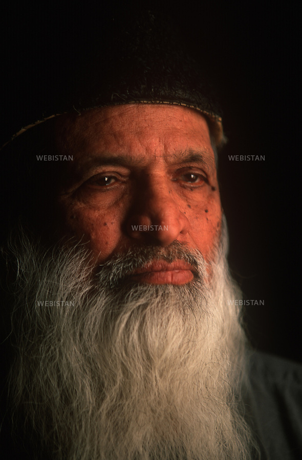 KARACHI, PAKISTAN - JANUARY, 2007: Portrait of Abdul Sattar Edhi, the founder of the Edhi Foundation who dedicates all his life to those who are less privileged, ill, handicapped, destitute and needy without any expectation.Established  in 1947, Edhi Foundation is the biggest social welfare and a non-governmental organization in Pakistan. Working without any discrimination on the basis of colour, race, language, religion or politics, the Foundation provides social services such as medical care, emergency services, ambulances, burial services, mental habitats, orphanage, child welfare services, abused women safe houses and training facilities for the disadvantaged. (Photo by Reza/Reportage by Getty Images)