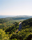 CROATIA, Hvar, Dalmatian Coast, high angle view of a road with vineyard fields in the background