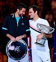 Roger Federer of Switzerland and Marin Cilic of Croatia with their trophies on Day 14 of the Australian Open