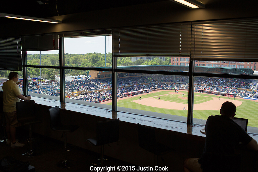 Employees watch the end of a Durham Bulls minor league baseball game at the Automated Insights office overlooking the Durham Bulls Athletic Park in Durham, N.C. on Thursday, May 7, 2015. An Automated Insights algorithm was recently pitted against an NPR reporter to see who could write the best news brief about a Denny's earnings report. (Justin Cook)