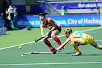 The Hague, Netherlands, June 12: Julia Reinprecht #12 of USA passes the ball during the field hockey semi-final match (Women) between USA and Australia on June 12, 2014 during the World Cup 2014 at Kyocera Stadium in The Hague, Netherlands. Final score after full time 2-2 (0-1). Score after shoot-out 1-3. (Photo by Dirk Markgraf / www.265-images.com) *** Local caption *** Julia Reinprecht #12 of USA, Emily Smith #26 of Australia