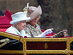 """THE QUEEN APPEARS TO BE GIVING CAMILLA TIPS ON WAVING TO THE CROWDS.The Queen was riding in the carriage with Prince Charles and Camilla for the trip from Westminster Hall to Buckingham Palace for the Finale of the 4 day Diamond Jubilee Celebration.  London_05/06/2012.Mandatory Credit Photo: ©J Reynolds/NEWSPIX INTERNATIONAL..**ALL FEES PAYABLE TO: """"NEWSPIX INTERNATIONAL""""**..IMMEDIATE CONFIRMATION OF USAGE REQUIRED:.Newspix International, 31 Chinnery Hill, Bishop's Stortford, ENGLAND CM23 3PS.Tel:+441279 324672  ; Fax: +441279656877.Mobile:  07775681153.e-mail: info@newspixinternational.co.uk"""