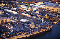 Aerial view of Navy aircraft carrier and commercial ships at Newport News. Shipbuilding on the James River, Newport News, VA. Industry. Newport News Virginia USA Hampton Roads.
